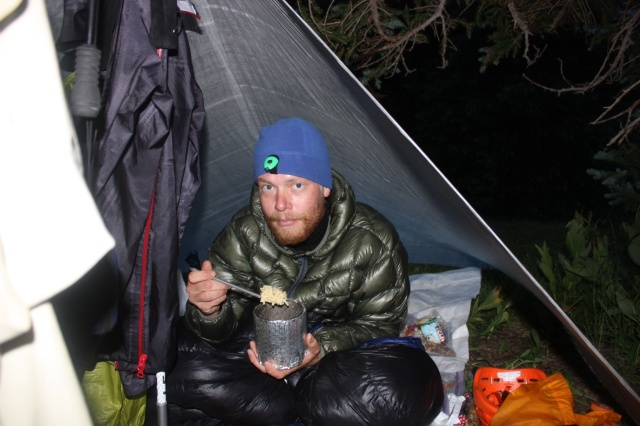 Junaid eating in camp at Chicago Basin after a 4 peak day.