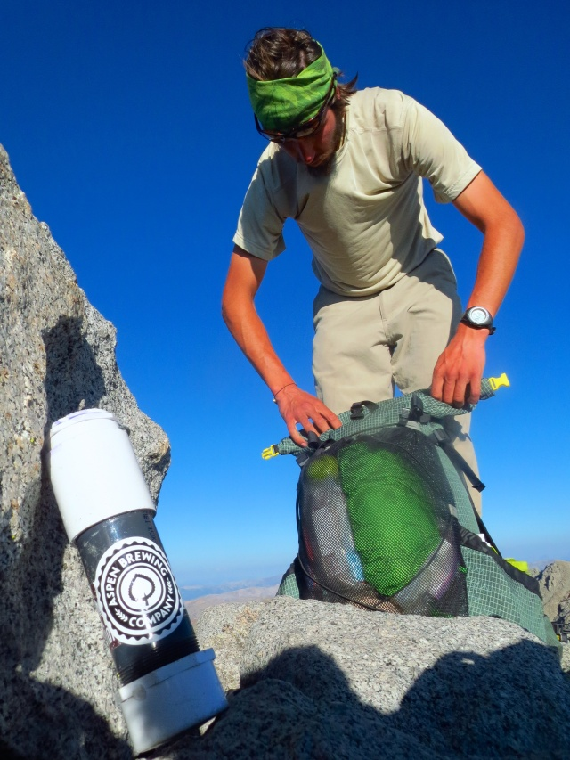 Luke packs up on the Shavano summit.