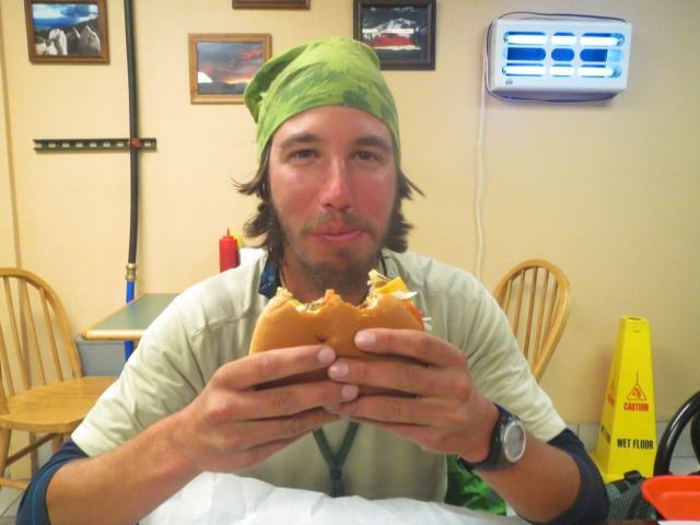 Luke enjoys a mountain burger at The Mountain Burger at the gas station in Florissant. One of the best burgers on the route!