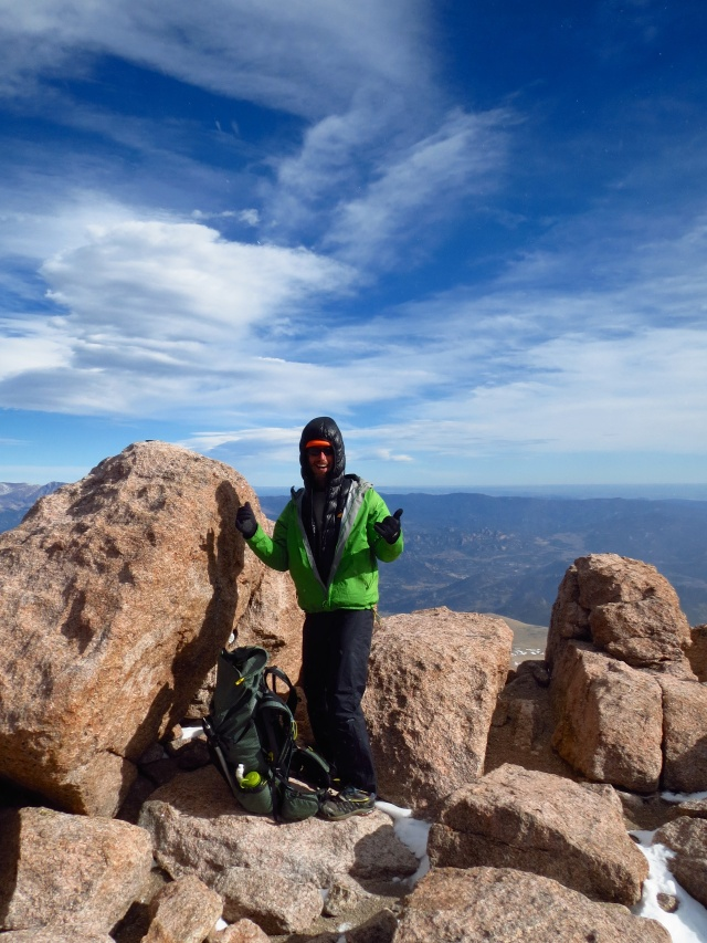 Luke with the Longs Peak summit register.