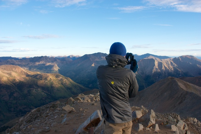 Junaid capturing a panorama on Huron's summit.