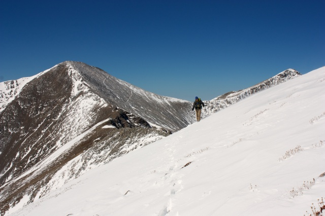 Junaid heads towards Argentine Pass with Toreey's and Gray's Peak in the background.